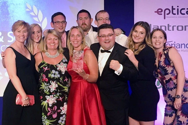Customer services team with award